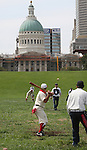 A Lafayette Cyclone hurler (pitcher) throws to a Belleville Stags striker (batter) in their Saturday August 18 game under the Gateway Arch on the St. Louis riverfront. These two teams, and a third - the St. Louis Unions - competed in a series of round-robin exhibition games to build interest in vintage base ball.