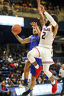 Washington, DC - December 22, 2018: Hampton Pirates guard Jermaine Marrow (2) is fouled by Howard Bison guard RJ Cole (2) during the DC Hoops Fest between Hampton and Howard at  Entertainment and Sports Arena in Washington, DC.   (Photo by Elliott Brown/Media Images International)
