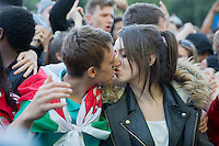 Wales fans celebrate their side's second goal with a kiss at the Cardiff Fanzone during the Euro 2016 quarter final between Wales and Belgium , Cardiff, Wales on 1 July 2016. Photo by Mark  Hawkins/PRiME Media Images.