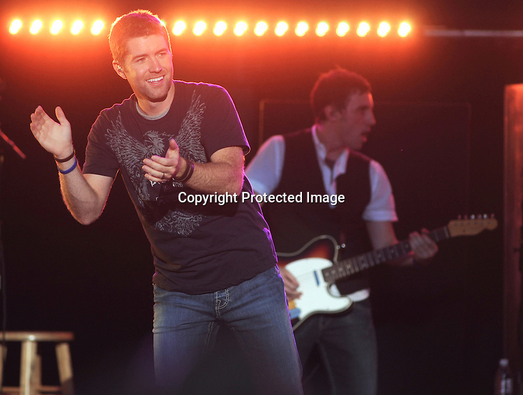 Photo by Mike Ullery.Josh Turner performs at Country Concert in the Hills at Hickory Hills Lake near Ft. Loramie, Ohio on Saturday, July 12, 2008.
