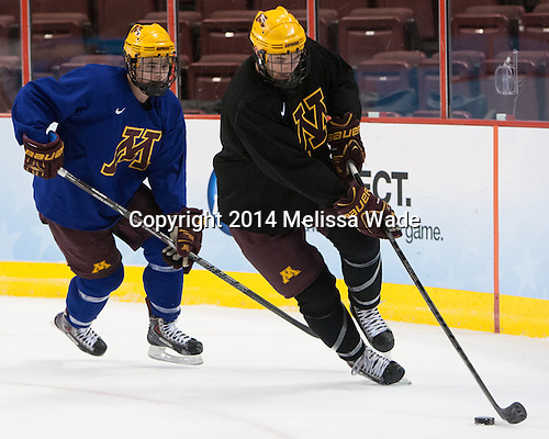 Connor Reilly (MN - 21), Seth Ambroz (MN - 17) - The University of Minnesota Golden Gophers practiced on Wednesday, April 9, 2014, at the Wells Fargo Center in Philadelphia, Pennsylvania during the 2014 Frozen Four.