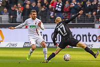 Marco Richter (FC Augsburg) gegen Sebastian Rode (Eintracht Frankfurt) - 14.04.2019: Eintracht Frankfurt vs. FC Augsburg, Commerzbank Arena, 29. Spieltag DISCLAIMER: DFL regulations prohibit any use of photographs as image sequences and/or quasi-video.