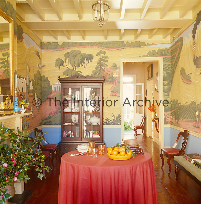 The living room is decorated with a scenic wallpaper depicting local life and which was designed by Thomas Jayne