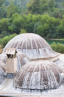 Roof top with domes and chimney. Pocitelj historic Muslim and Christian village near Mostar. Federation Bosne i Hercegovine. Bosnia Herzegovina, Europe.
