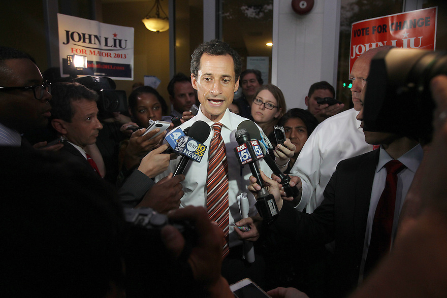 Anthony Weiner  answer questions from the media after the Voces Latinas Mayoral Forum on Thursday, July 25, 2013 in Queens, New York. (AP Photo/ Donald Traill)