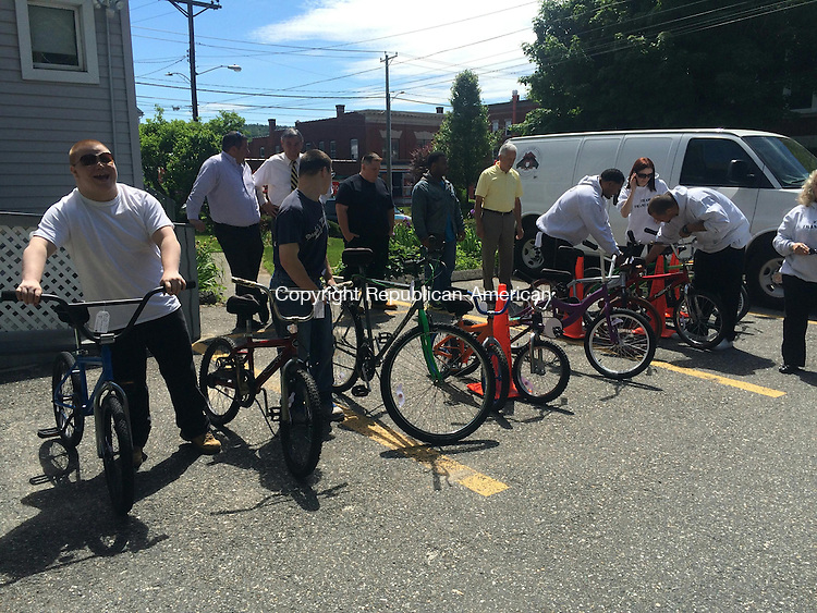 TORRINGTON, CT- 05 June 2015-060515CH1-- LARC Sstudents set up bicycles to present to FISH after refurbishing them as a class project. Carrie Grace Henderson Republican-American