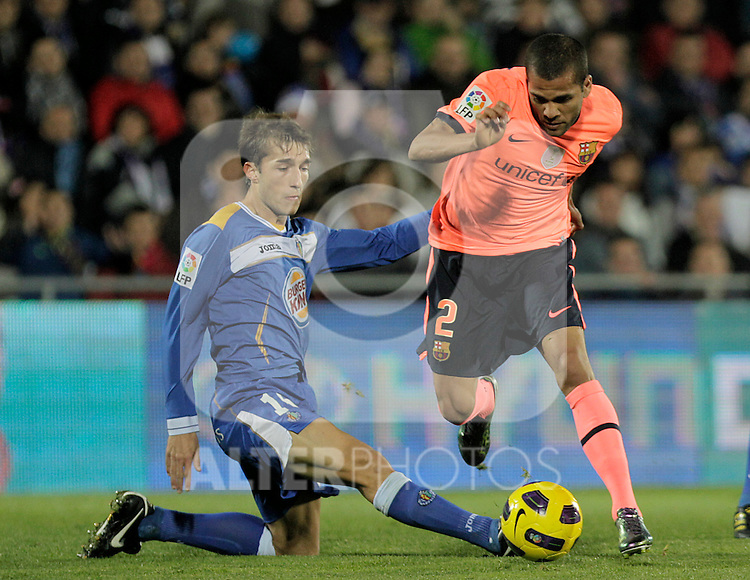 FC Barcelona's Daniel Alves (r) and Getafe's Rafa Lopez during La Liga match.November 07,2010. (ALTERPHOTOS/Acero)