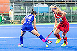 Katie Bam #16 of United States carries the ball past Emi Nishikori #14 of Japan during USA vs Japan in a Pool B game at the Rio 2016 Olympics at the Olympic Hockey Centre in Rio de Janeiro, Brazil.