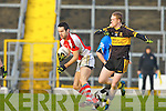 Tom O'Sullivan Rathmore collides with Colm Cooper Crokes during the O'Donoghue Cup final in Fitzgerald Stadium on Sunday