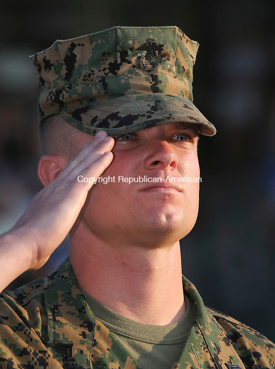 NEW BRITAIN,  CT 10 August 2005 -081005BZ13- Former New Britain Rock Cats shortstop and current Marine Cpl. Tony Stevens salutes during the National Anthem while being honored for his military service before the game Wednesday.<br /> Jamison C. Bazinet Photo
