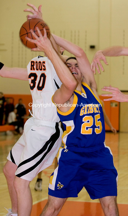 TERRYVILLE, CT - 17 DECEMBER 2008 -121708JT11-<br /> Terryville's Jason Pranulis and Gilbert's John Tessman scramble for a rebound during Wednesday's game at Terryville. At right is Terryville's Mike Garrow. Terryville won, 61-45.<br /> Josalee Thrift / Republican-American