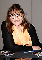 MARGOT KIDDER  At the London Film & Comic Convention, Day 1, Earls Court 2 Exhibition Centre, London, England, 19th July 2008. half length glasses yellow black sitting table  CAP/CAN ©Can Nguyen/Capital Pictures