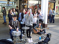 Teenagers busking in city centre, Cambridge..