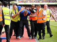 Pictured: A Crystal Palace supporter is taken away by force by stadium stewards<br />
