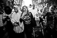 ©VIRGINIE NGUYEN HOANG.Egypt,Cairo.November 2012..Thousands of protesters marched on Monday to commemorate the death of activist Gaber Salah (Gika) who was a member of the April 6 youth movement. The funeral procession moved from Omar Makram Mosque to Mohamed Mahmoud Street then to Tahrir Square down to his burial chamber..Gika died on Sunday after being shot during friday protest. ..