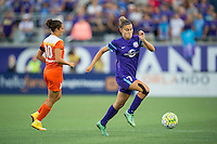 Orlando, Florida - Saturday, April 23, 2016: Orlando Pride defender Stephanie Catley (7) dribbles away from Houston Dash midfielder Carli Lloyd (10) during an NWSL match between Orlando Pride and Houston Dash at the Orlando Citrus Bowl.
