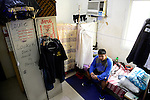 QATAR, Doha, housing complex for migrant worker outside the city, six filipino worker share a 10 square meter room / KATAR, Doha, Sammelunterkunft fuer Gastarbeiter, sechs philippinische Gastarbeiter muessen sich einen zehn Quadratmeter grossen Raum teilen
