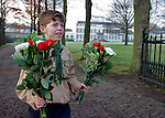 An unidentified boy scout holds flowers in front of the Soestdijk palace to pay his last respects to Dutch Prince Bernhard who died in a hospital in Utrecht, the Netherlands, December 1, 2004. Prince Bernhard, father of Dutch Queen Beatrix, died at the age of 93. REUTERS/Michael Kooren