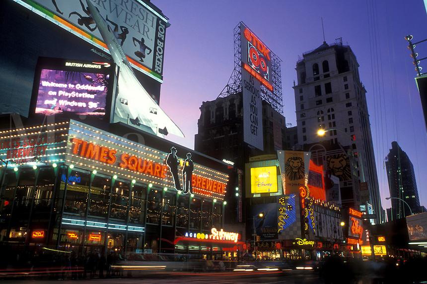 New York City, Manhattan, New York, Time Square illuminated at night along Broadway in Midtown Manhattan.