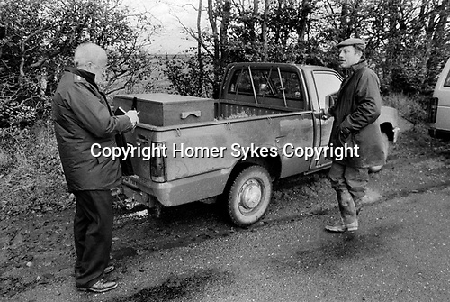 Puppy Farming Wales 1989. RSPCA inspectors stops a know puppy breeder with dog carrying box in the rear of his van. There are no air holes.