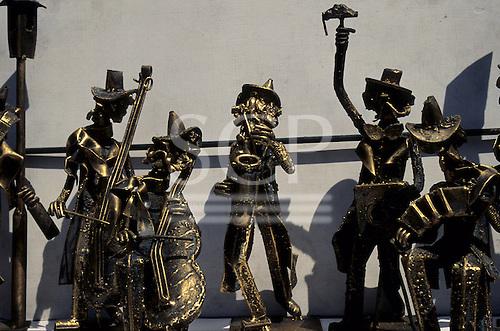 Buenos Aires, Argentina. Bronze statuettes of musicians (double bass, cello, saxophone, squeezebox).