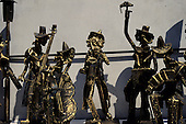 Buenos Aires, Argentina. Bronze statuettes of musicians (double bass, cello, saxophone, squeezebox).