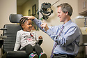 Pediatric ophthalmologist David Wallace, MD, examines McKenzie Glover at the Duke Eye Center. Wallace is the principal investigator of the Pediatric Eye Disease Investigator Group (PEDIG).