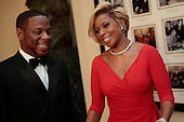 Singer Mary J Blige, right, and Kendu Isaacs arrive to a state dinner hosted by U.S. President Barack Obama and U.S. First Lady Michelle Obama in honor of French President Francois Hollande at the White House in Washington, D.C., U.S., on Tuesday, Feb. 11, 2014. Obama and Hollande said the U.S. and France are embarking on a new, elevated level of cooperation as they confront global security threats in Syria and Iran, deal with climate change and expand economic cooperation. <br /> Credit: Andrew Harrer / Pool via CNP