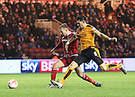 Jordan Rhodes of Middlesbrough and Danny Batth of Wolverhampton Wanderers both stretching towards the ball - Sky Bet Championship - Middlesbrough vs Wolverhampton Wanderers - Riverside Stadium - Middlesbrough - England - 4th of March 2016 - Picture Jamie Tyerman/Sportimage