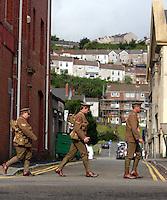 Men in World War I gear in the High Street Swansea, south Wales UK. Friday 01 July 2016