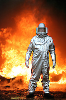 Firefighter in protective aluminium suit at aircraft fire. This image may only be used to portray the subject in a positive manner..©shoutpictures.com..john@shoutpictures.com