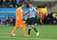 Uruguay Goalkeeper Fernando Muslera and Jose Gimenez celebrate Suarez winner