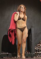 12 July, 2008:    Miss Pierce County Elizabeth Lamb-Ferro shows off her swim attire in the Physical Fitness in Swimsuit competition on stage during the 2008 Miss Washington pageant at the Pantages Theater in Tacoma , Washington.