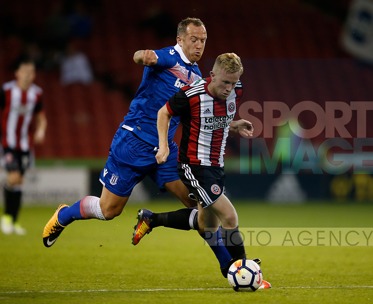 Charlie Adam of Stoke City with Mark Duffy of Sheffield Utd during the pre season friendly at Bramall Lane Stadium, Sheffield. Picture date: July 25th 2017. Picture credit should read: Simon Bellis/Sportimage