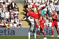 Barclay Premier League, Swansea City (white) V Liverpool (red) Liberty Stadium, 13/05/12<br /> Pictured: Jonjo Shelvey climbs on the back of Gylfi Sigurdson<br /> Picture by: Ben Wyeth / Athena <br /> info@athena-pictures.com