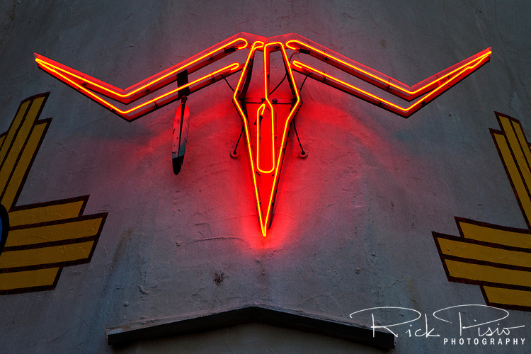 Neon steer skull on the exterior of the Tee Pee Curios shop along Route 66 in Tucamcari, New Mexico.