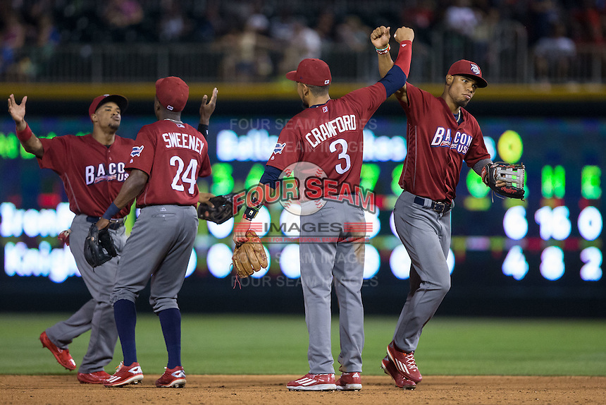 (R-L) Nick Williams (4), J.P. Crawford (3), Darnell Sweeney (24), and Cedric Hunter (21) celebrate their win over the Charlotte Knights at BB&T BallPark on June 3, 2016 in Charlotte, North Carolina.  The Iron Pigs defeated the Knights 6-4.  (Brian Westerholt/Four Seam Images)