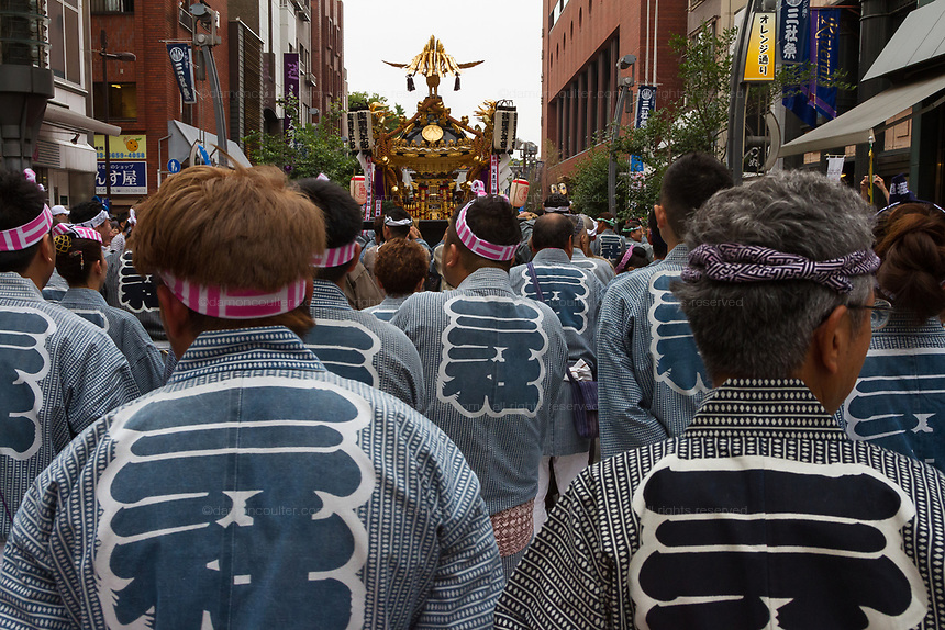 Mikoshi, or portable shrines, are carried around the streets on  first day of the three-day Sanja Matsuri, Asakusa, Tokyo, Japan. Friday May 18th 2018. The Sanja matsuri, or festival, takes place over the third weekend of May in the streets around the famous Senso-ji Temple. It lis one of the biggest festivals in Japan and lasts for three days  (May 18th to May 20th) with parades of large mikoshi,carried around the streets by crowds of supporters
