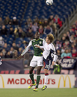 Portland Timbers midfielder James Marcelin (14) and New England Revolution forward Zack Schilawski (15) battle for head ball. In a Major League Soccer (MLS) match, the New England Revolution tied the Portland Timbers, 1-1, at Gillette Stadium on April 2, 2011.