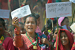 "Women gather to celebrate International Women's Day on March 8, 2016, in Dhawa, a village in the Gorkha District of Nepal.<br /> <br /> The woman on the left holds a sign reading, ""We demand equality."""