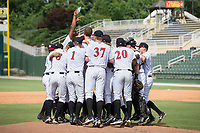 The Kannapolis Intimidators celebrate on the pitcher's mound after their win over the West Virginia Power clinched the South Atlantic League Northern Division first half title at Kannapolis Intimidators Stadium on June 18, 2017 in Kannapolis, North Carolina.  The Intimidators defeated the Power 5-3.   It is the first trip to the playoffs for the Intimidators since 2009.  (Brian Westerholt/Four Seam Images)