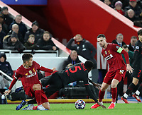 11th March 2020; Anfield, Liverpool, Merseyside, England; UEFA Champions League, Liverpool versus Atletico Madrid;  Thomas Partey of Atletico Madrid is tripped by Roberto Firmino of Liverpool
