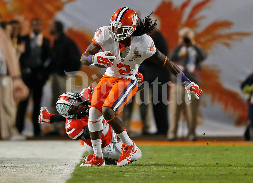 Ohio State Buckeyes linebacker Ryan Shazier (2) takes Clemson Tigers wide receiver Sammy Watkins (2) out of bounds in the first quarter of the Discover Orange Bowl between Ohio State and Clemson at Sun Life Stadium in Miami Gardens, Florida, Friday night, January 3, 2014. As of half time the Ohio State Buckeyes led the Clemson Tigers 22 - 20.(The Columbus Dispatch / Eamon Queeney)