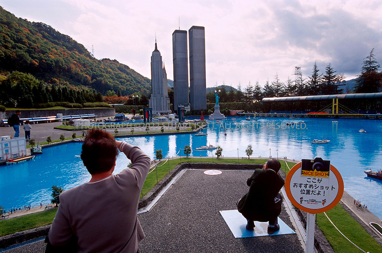 11/2/2001--Kasogoe, Tochigi Prefecture, Japan..Models of New York's World Trade Center towers stand at the Tobu World Square park in Kasogoe, about 2 hours north of Tokyo. The park features over 100 reproductions of world famous landmarks at 1/25th scale and the WTC stands 17 meters tall, towering over other models and even nearby homes. The parks officals claim they are the biggest models of the towers in the world...All photographs ©2003 Stuart Isett.All rights reserved.This image may not be reproduced without expressed written permission from Stuart Isett.