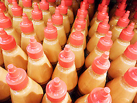 Squeeze bottles of Sriracha mayonnaise in a supermarket in New York on Wednesday, September 24, 2014. (© Richard b. Levine)