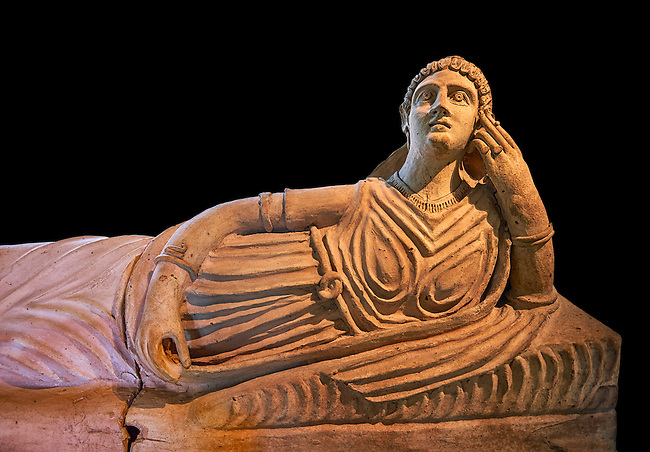 Etruscan Terracotta sarcophagus lid with a female figure reclining, first half of 2nd century BC, inv 15428, The Vatican Museums Rome, Black Background. For use in non editorial advertising apply to the Vatican Museums for a license.