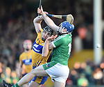 John Conlon of  Clare  in action against Richie Mc Carthy of  Limerick during their NHL quarter final at the Gaelic Grounds. Photograph by John Kelly.