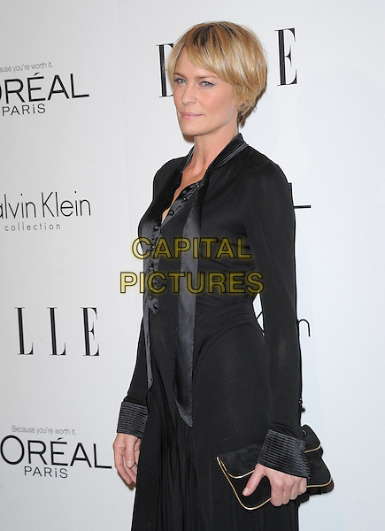 Robin Wright.18th Annual ELLE Women in Hollywood celebration held at The Four Seasons in Beverly Hills, California, USA..October 17th, 2011.half length black dress clutch bag blazer skirt scarf short cropped hair .CAP/RKE/DVS.©DVS/RockinExposures/Capital Pictures.