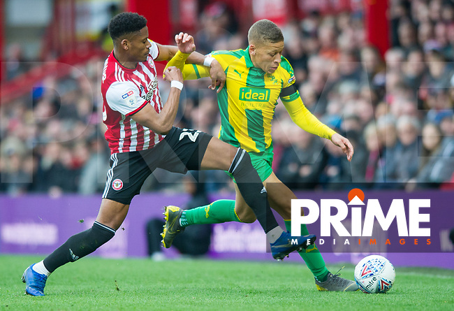 WBA's Dwight Gayle and Brentford Julian Jeanvier during the Sky Bet Championship match between Brentford and West Bromwich Albion at Griffin Park, London, England on 16 March 2019. Photo by Andrew Aleksiejczuk / PRiME Media Images.