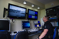 Pictured: PC Brian Thorne watches the thermal images from he sky mantis drone in action at Caerphilly RFC, Wales, UK. Thursday 13 June 2019<br /> Re: Gwent Police Force has held a live demonstration of their brand new, purpose built police drones, on the grounds of Caerphilly RFC, Wales, UK.<br /> The Force now has 25 specially trained and qualified officers who are also drone pilots giving 24/7 coverage. <br /> All officers have passed a Civil Aviation Authority (CAA) accredited training and are qualified remote pilots.